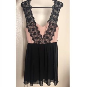 Beige and black dress with lace trim